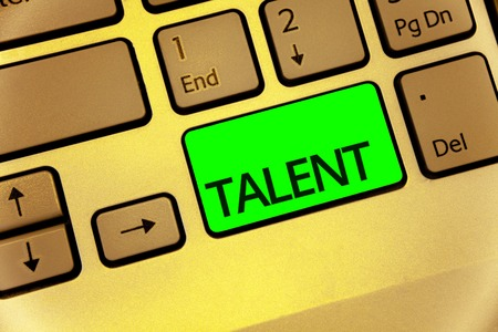 Text sign showing Talent. Conceptual photo Natural abilities of people showing specialized skills they possess Keyboard key laptop creative computer brown keypad idea notebook netbook Stock Photo