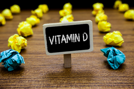 Conceptual hand writing showing Vitamin D. Business photo showcasing Benefits of sunbeam exposure and certain fat soluble nutriments Creative idea paper object inspiration several tries