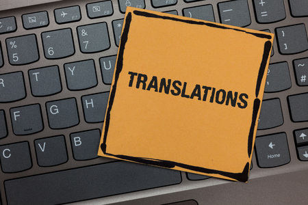 Handwriting text writing Translations. Concept meaning Written or printed process of translating words text voice Black laptop keyboard art paper computer notebook netbook keypad key Imagens