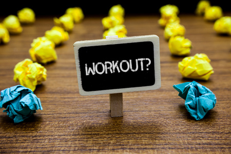 Conceptual hand writing showing Workout Question. Business photo showcasing Activity for wellness bodybuilding training exercising Creative idea paper object inspiration several tries