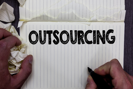 Handwriting text writing Outsourcing. Concept meaning Obtain goods or service by contract from an outside supplier Notebook register handwork line drawing child learn study tear pages Banque d'images