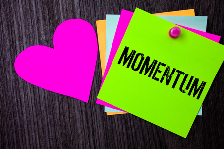 Conceptual hand writing showing Momentum. Business photo text Quantity motion in moving body Product of mass and velocity Pinned multi colour cards heart polish dark lining background