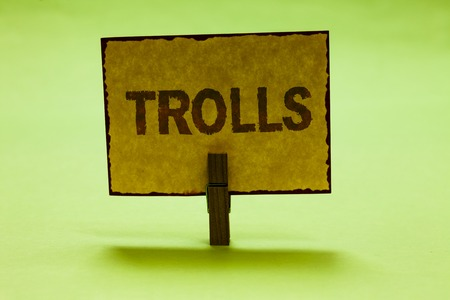 Conceptual hand writing showing Trolls. Business photo text Online troublemakers posting provocative inflammatory messages Nice lime colour shadow billboard important clip paperclip ideas Stock Photo