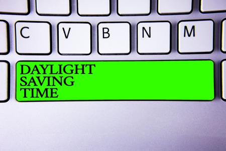 Conceptual hand writing showing Daylight Sayving Time. Business photo showcasing advancing clocks during summer to save electricity Spacebar laptop keyboard white computer grey background