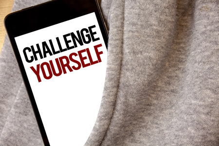 Handwriting text writing Challenge Yourself. Concept meaning Overcome Confidence Strong Encouragement Improvement Dare Hoar frost color side pocket cell phone be visible black and red letters Stock Photo