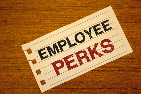Writing note showing  Employee Perks. Business photo showcasing Worker Benefits Bonuses Compensation Rewards Health Insurance Text two word white paper note wood desk quick sketch school work pen Banco de Imagens