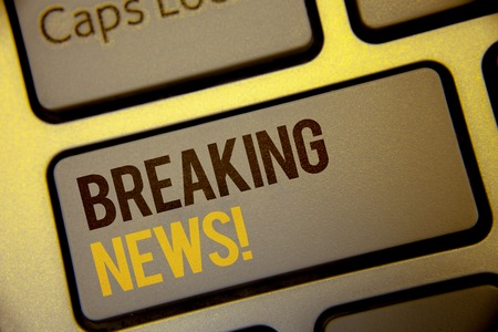 Handwriting text Breaking News Motivational Call. Concept meaning Updated press report Latest information Text two Words written Computer Keyboard Left Shift Key Button work press