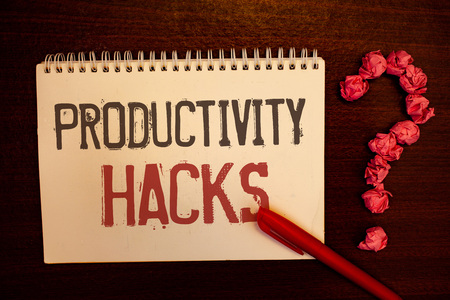 Handwriting text Productivity Hacks. Concept meaning Hacking Solution Method Tips Efficiency Productivity Reddish paper balls structures question mark red pen notebook browny desk 写真素材