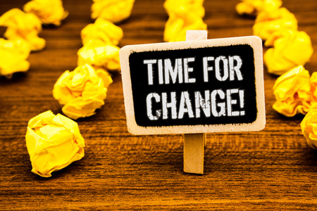 Handwriting text writing Time For Change Motivational Call. Concept meaning Transition Grow Improve Transform Develop White text black paint wooden board clip desk yellow paper notes warning
