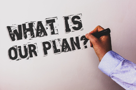 Handwriting text What Is Our Plan Question. Concept meaning Mission Purpose Agenda Strategize Brainstorming Advisors hand holding black marker whiteboard written black color words