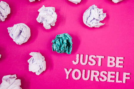 Text sign showing Just Be Yourself. Conceptual photo Self Attitude Confidence True Confident Honesty Motivation Text Words pink background crumbled paper notes white blue stress angry Stock Photo