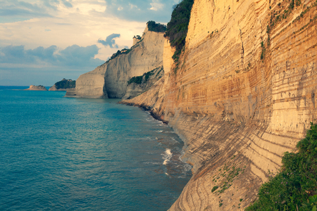 Sedimentary Rock Cliff at the sea, Limestone Natural Structure Coast, Mointain Chain of Layered Stone Formation along the Beach High Shoreline Eroded Crag