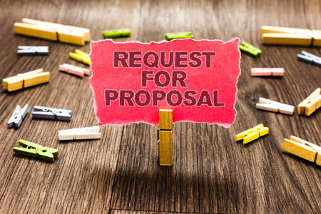 Conceptual hand writing showing Request For Proposal. Business photo text document contains bidding process by agency or company Clips spread woody table learn study things class schooling