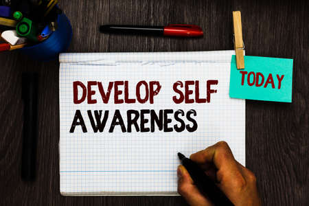 Conceptual hand writing showing Develop Self Awareness. Business photo text increase conscious knowledge of own character Register pages handwriting text work stationery items woody table Foto de archivo