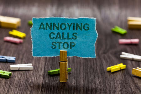 Text sign showing Annoying Calls Stop. Conceptual photo Prevent spam phones Blacklisting numbers Angry caller Clips symbol idea script notice board text capital cardboard design
