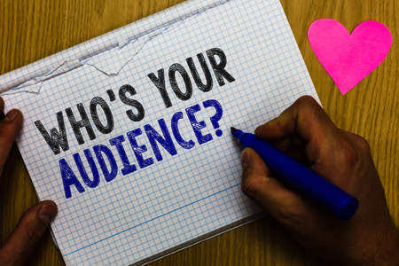 Handwriting text Who s is Your Audience question. Concept meaning asking someone about listeners category Coaching Paper register multiline text pen handwriting love heart table background