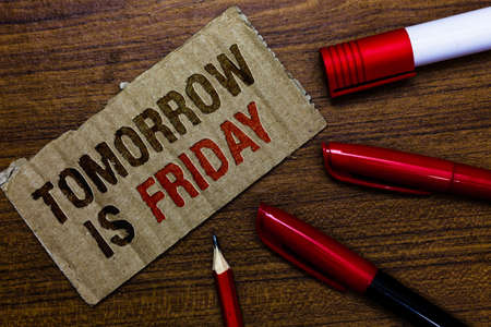 Word writing text Tomorrow Is Friday. Business concept for Weekend Happy holiday taking rest Vacation New week Pen pencil cap board marker pointer text cardboard notice script idea