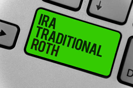 Conceptual hand writing showing Ira Traditional Roth. Business photo showcasing are tax deductible on both state and federal Computer program keyboard typing office work input device Stock Photo