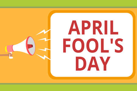 Writing note showing April Fool s is Day. Business photo showcasing Practical jokes humor pranks Celebration funny foolish Message idea invention boxed script public loud speaker announcement Banco de Imagens