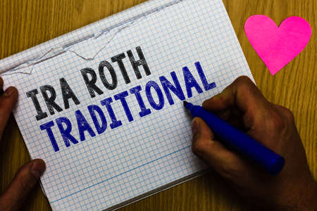 Handwriting text Ira Roth Traditional. Concept meaning are tax deductible on both state and federal Paper register multiline text pen handwriting love heart table background Stock Photo