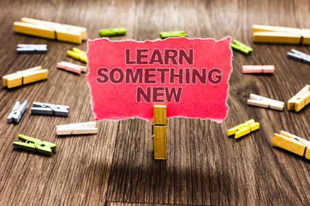 Conceptual hand writing showing Learn Something New. Business photo text being taught new subject activity Knowledge or sport Clips spread woody table learn study things class schooling