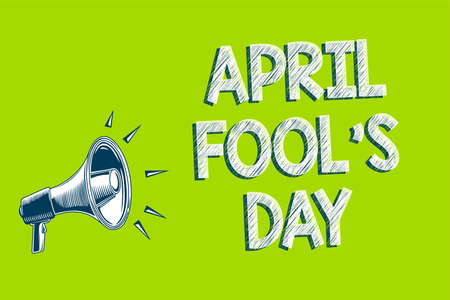 Writing note showing April Fool s is Day. Business photo showcasing Practical jokes humor pranks Celebration funny foolish Artwork convey message speaker alarm announcement green background