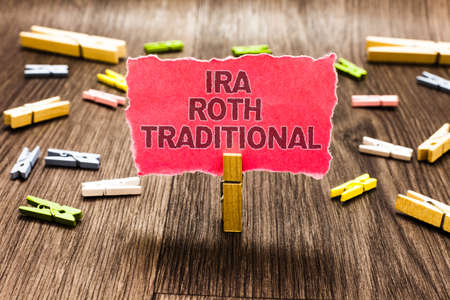 Conceptual hand writing showing Ira Roth Traditional. Business photo text are tax deductible on both state and federal Clips spread woody table learn study things class schooling Stock Photo