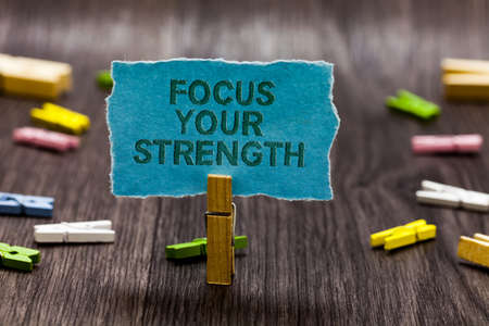Text sign showing Focus Your Strength. Conceptual photo Improve skills work on weakness points think more Clips symbol idea script notice board text capital cardboard design Reklamní fotografie