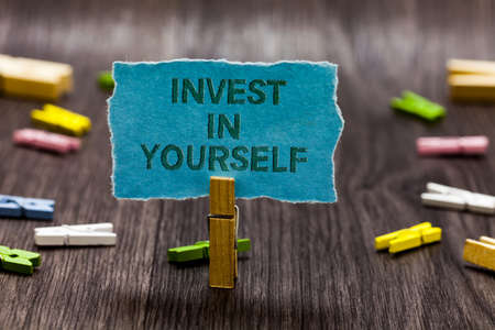 Text sign showing Invest In Yourself. Conceptual photo Improve your Skills take courses Do masters Scholarship Clips symbol idea script notice board text capital cardboard design Standard-Bild