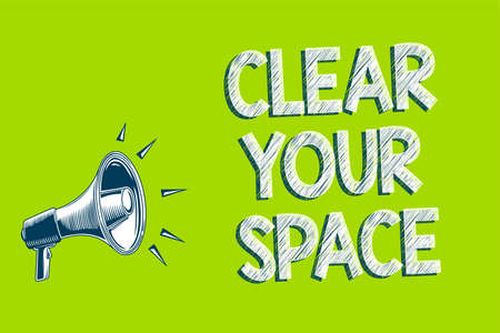 Writing note showing Clear Your Space. Business photo showcasing Clean office studio area Make it empty Refresh Reorganize Artwork convey message speaker alarm announcement green background