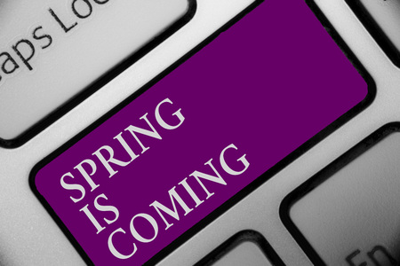 Handwriting text Spring Is Coming. Concept meaning After winter season is approaching Enjoy nature flowers sun Keyboard button hit key type message office work computer input device