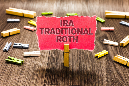 Conceptual hand writing showing Ira Traditional Roth. Business photo text are tax deductible on both state and federal Clips spread woody table learn study things class schooling Stock Photo