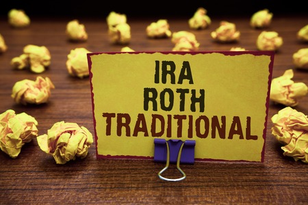Handwriting text writing Ira Roth Traditional. Concept meaning are tax deductible on both state and federal Yellow sticky card clipped text notice crumpled paper balls wood table