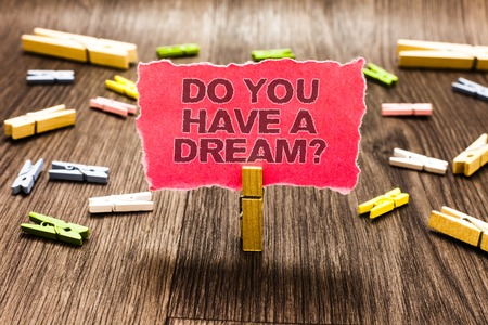 Conceptual hand writing showing Do You Have A Dream question. Business photo text asking someone about life goals Achievements Clips spread woody table learn study things class schooling