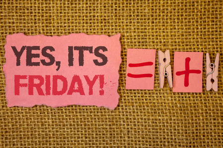 Handwriting text writing Yes, ItS Friday Motivational Call. Concept meaning having weekend Taking rest break Jute sacks plus two paper clip equal pink paper with black and red letter Stock Photo
