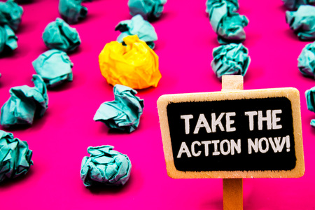 Conceptual hand writing showing Take The Action Now Motivational Call. Business photo text Act Start Promptly Immediate Instantly Blackboard with white letter pink base much green paper lobs Stock fotó
