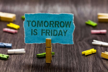 Text sign showing Tomorrow Is Friday. Conceptual photo Weekend Happy holiday taking rest Vacation New week Clips symbol idea script notice board text capital cardboard design