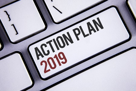 Writing note showing  Action Plan 2019. Business photo showcasing Challenge Ideas Goals for New Year Motivation to Start Keyboard gray keys black letters words Intention text on computer Stock Photo