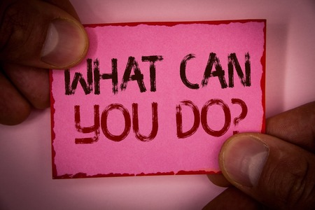Handwriting text What Can You Do Question. Concept meaning Service Determination Purpose Worth Contemplation Words written pink paper note red border fingers holding corners message Stock Photo