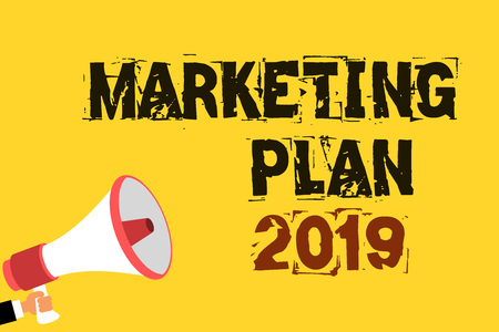 Handwriting text writing Marketing Plan 2019. Concept meaning schedule defining brand selling way in next year Multiline text notice board recall reassure public message yellow surface Stock Photo