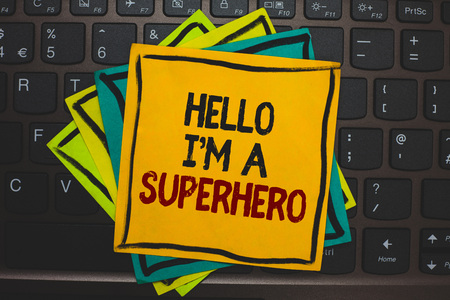 Word writing text Hello I am A Superhero. Business concept for Believing in yourself Self-confidence Introduction Multiple colour sticky border cards computer keyboard text send message Stock Photo