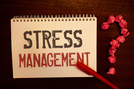 Handwriting text Stress Management. Concept meaning Meditation Therapy Relaxation Positivity Healthcare Reddish paper balls structures question mark red pen notebook browny desk