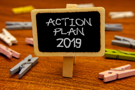 Conceptual hand writing showing Action Plan 2019. Business photo showcasing Challenge Ideas Goals for New Year Motivation to Start Blackboard chalk letters clothespin with wooden background Stock Photo