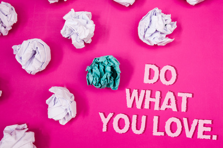 Text sign showing Do What You Love.. Conceptual photo Positive Desire Happiness Interest Pleasure Happy Choice Text Words pink background crumbled paper notes white blue stress angry