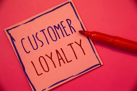 Writing note showing  Customer Loyalty. Business photo showcasing Client Satisfaction Long-Term relation Confidence Ideas concepts intentions on pink paper black letters frame red pen Stock Photo