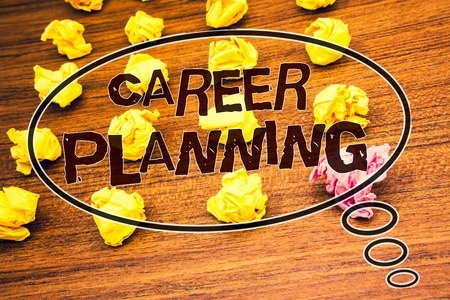 Word writing text Career Planning. Business concept for Professional Development Educational Strategy Job Growth Text wood desk crumbled paper notes yellow pink stress studying school