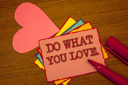 Handwriting text writing Do What You Love.. Concept meaning Positive Desire Happiness Interest Pleasure Happy Choice Text colorful paper notes pink heart red marker open cap desk message