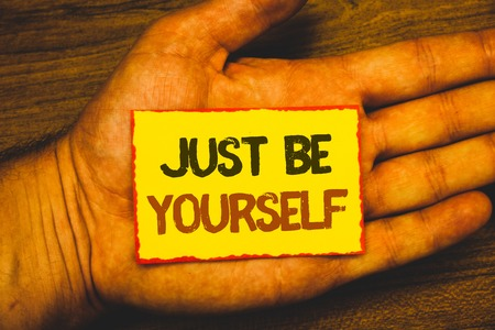 Conceptual hand writing showing Just Be Yourself. Business photo showcasing Self Attitude Confidence True Confident Honesty Motivation Text Words written yellow paper note red border message love Stock Photo