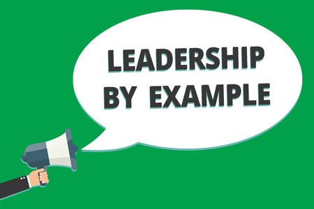 Handwriting text Leadership By Example. Concept meaning Becoming role model for people Have great qualities Message idea information text public loud speaker green plane background Stock Photo