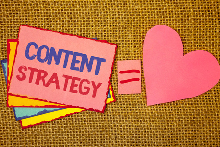 Writing note showing  Content Strategy. Business photo showcasing Management Network Internet Website Marketing Plan Pink yellow blue notes black red letters ideas equal sign heart wicker